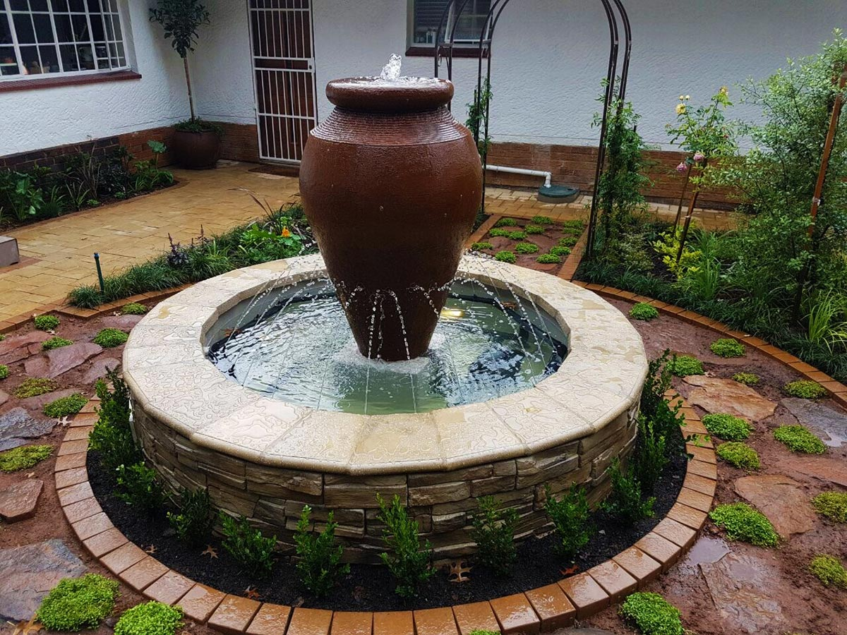 Water feature design installation living green gardens for Water feature design